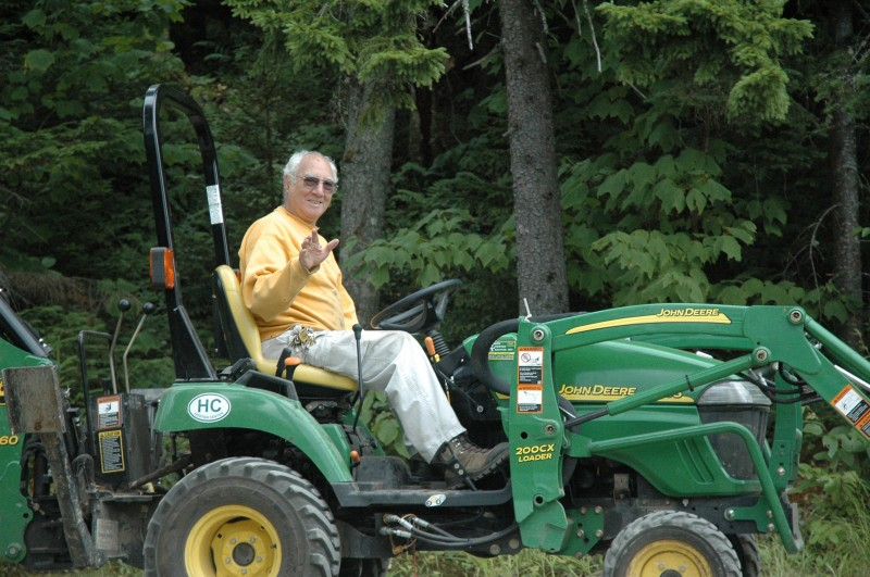 Merle on his trusty helper, Mr. Deere
